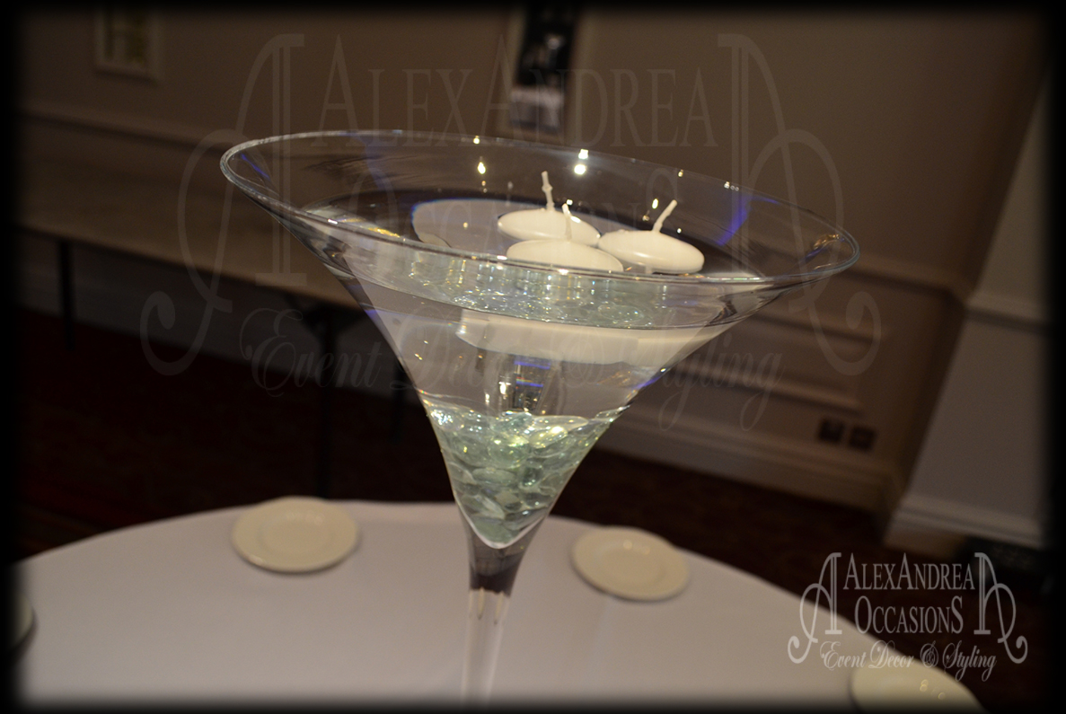 Table centrepiece hire for weddings events in london 60cm martini vase table centrepiece glass pebble floating candles hertfordshire reviewsmspy